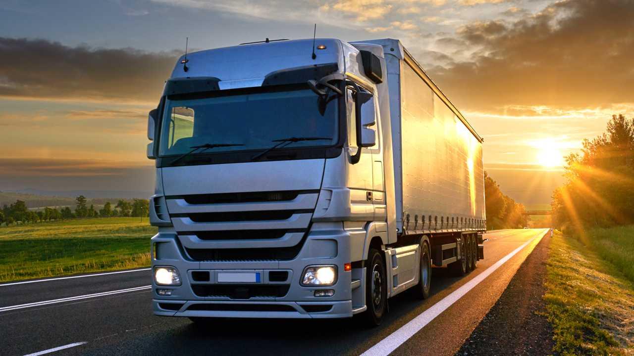 road freight large grey van